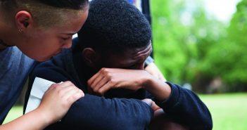 Teen boy being comforted
